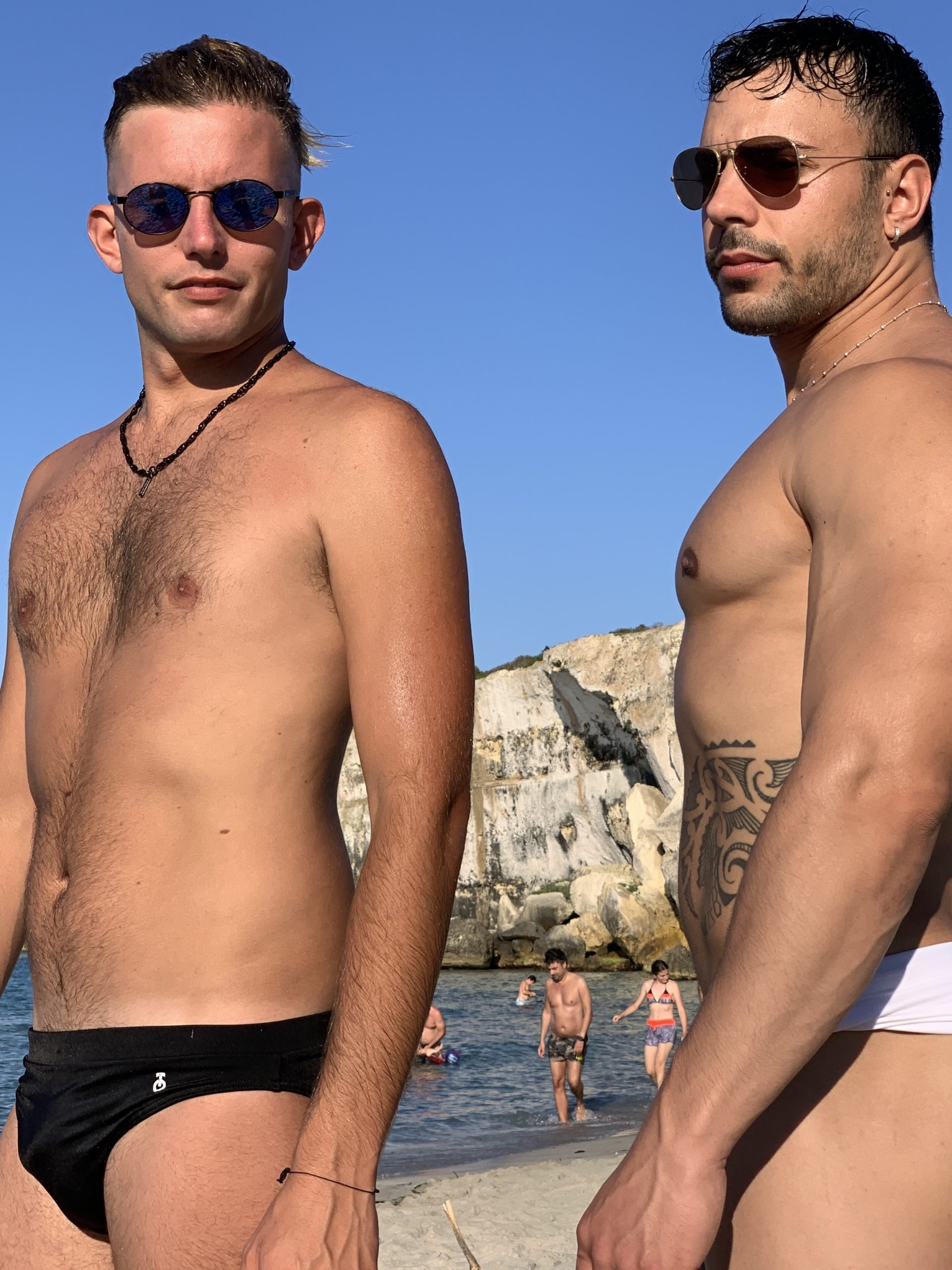 Some Italian guys enjoy the hot summer sun at Spiaggia delle Due Sorelle in Puglia. The Big Gay Podcast from Puglia - the definitive guide to gay Puglia.