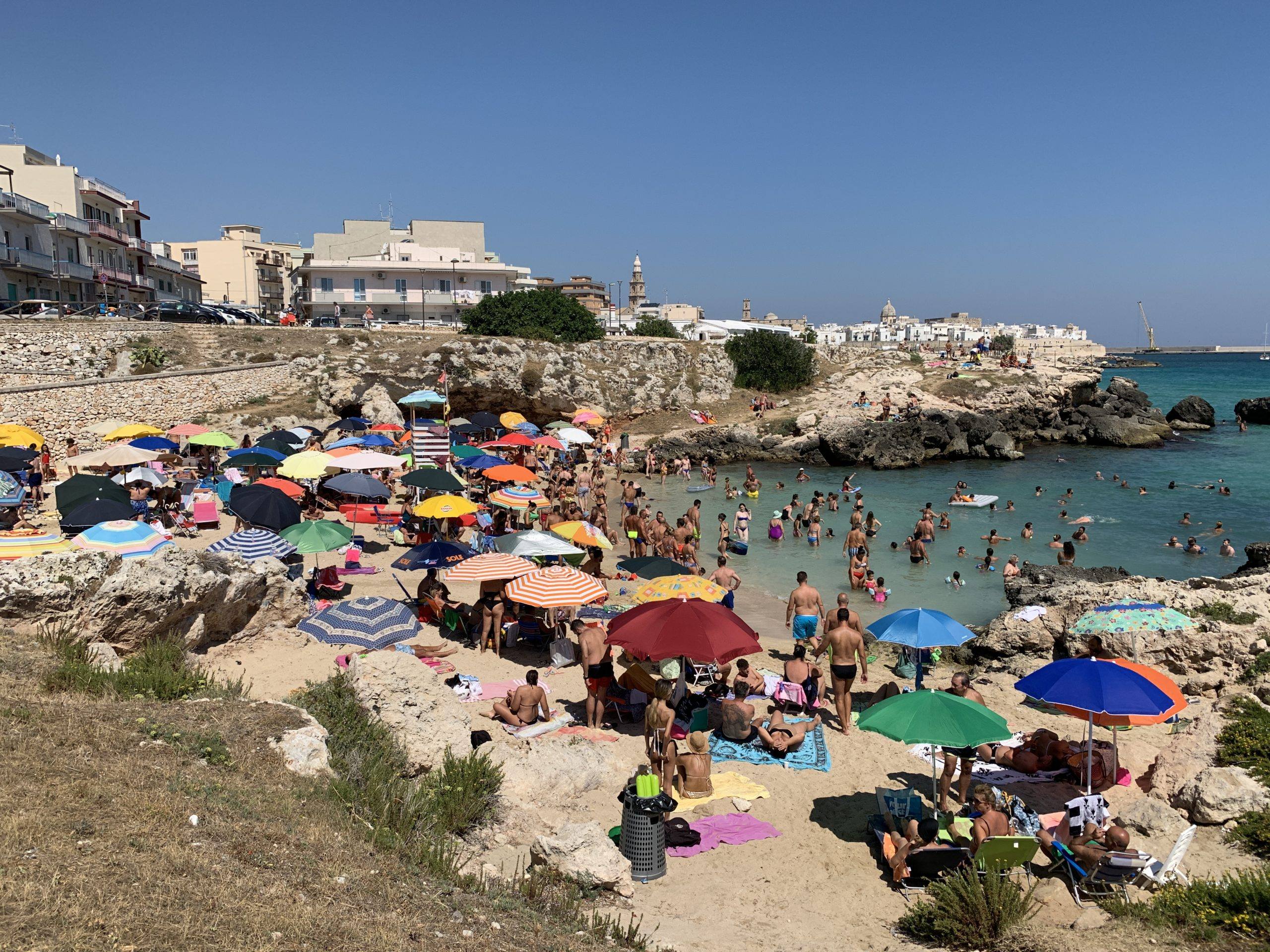 Porto Rosso beach in Monopoli, Puglia, is a bust town beach popular with locals.