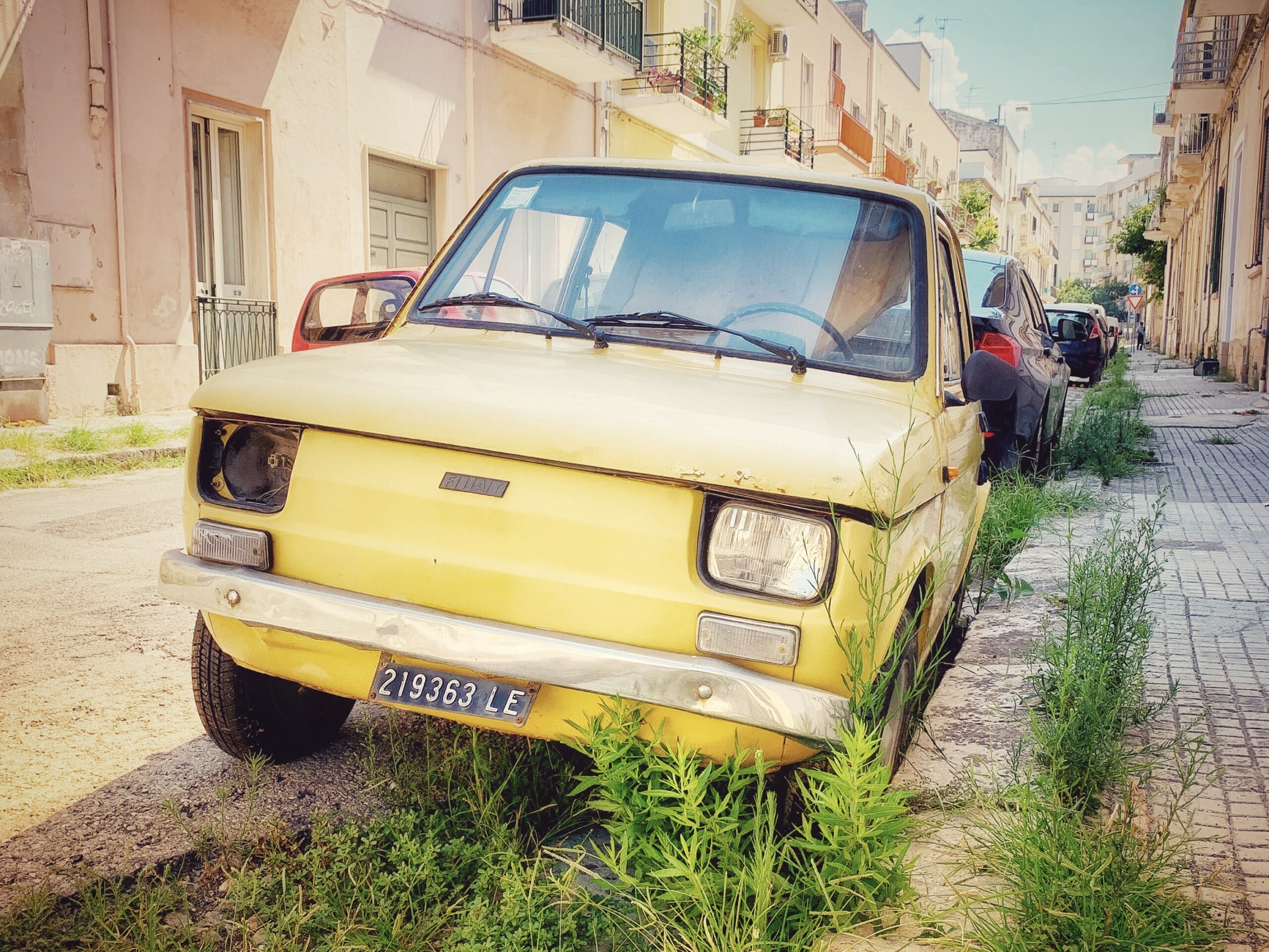 A car in Lecce, Puglia that has seen better times. Our guide to driving in Puglia.